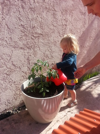 Ada gardening at the new house