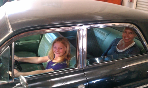 Amelia driving Amber in the Buick
